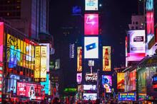 Illuminated Buildings At Night In City