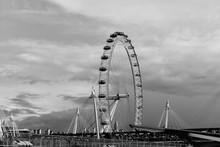 London Eye By Bridge Against Sky