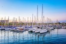 Sailboats Moored At Harbor Aga...