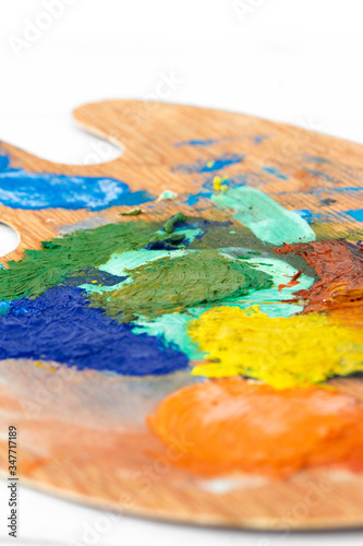 Photo Artist oil paint wooden palette,  with mixed  paint colours mixed