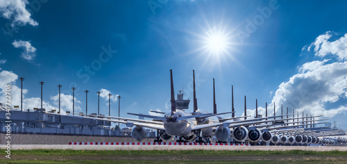 Fototapeta Commercial airplane parking at the airport are stopped effect by covid-19 pandemic around the world economic down crisis, Airplanes are parking at maintenance area because of COVID-19 travel alert obraz
