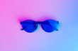 canvas print picture - Blue plastic glasses for night party, purple neon light, minimalism