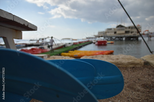 Canvas Print Close-up Of Blue Oars At Beach
