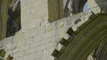 Pan Up On Rievaulx Abbey Ruins...