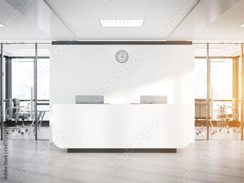 Fotografie, Obraz Blank white reception desk in concrete office with large windows Mockup 3D rende