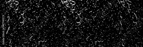 Fotografia Water drops as a dark background texture surface