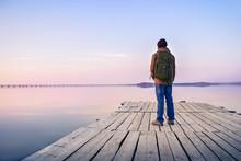 Man Walking On The Pier