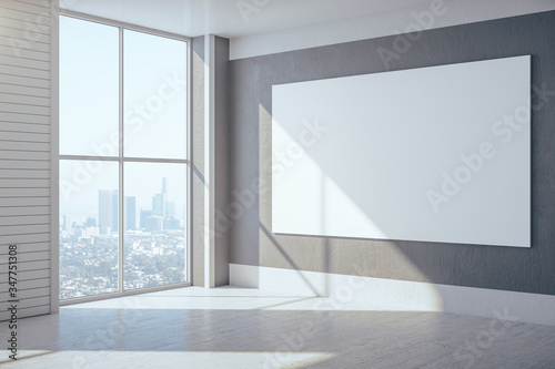 Fotografia New gallery with city view and empty banner on concrete wall.