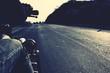 Leinwandbild Motiv Cropped Image Of Man Riding Motorcycle On Road