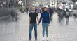 The man and woman stand in crowdy flow on holographic background. time lapse