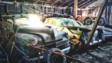 Abandoned Cars Parked At Garage