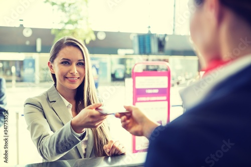 Photo Cutout of Young attractive businesswoman giving her passport to passenger servic