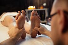 Massage Therapist Doing A Woma...