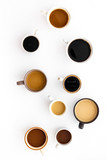 Cups of hot drinks on white desk top view