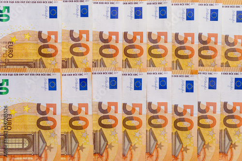 Valokuva Banknotes of 50 fifty euros lie exactly in two rows
