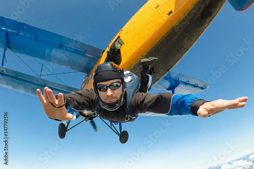 Male skydiver jumps from the aircraft Fototapeta