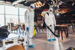 canvas print picture - Professional workers in hazmat suits disinfecting indoor of cafe or restaurant, pandemic health risk, coronavirus