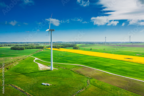 Fototapeta Green fields and wind turbine in spring, aerial view obraz