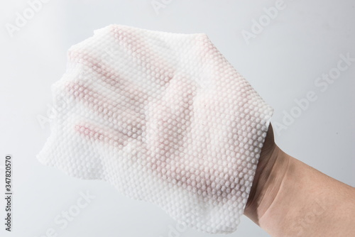 Cuadros en Lienzo A paper towel is held in one hand for thickness testing against a white background