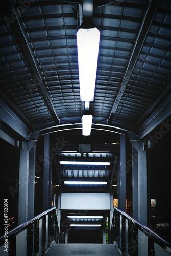 Stampa su Tela Illuminated Footbridge At Night