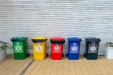 Set Of Recycle Waste Bins Near...
