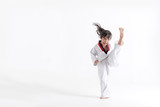 Asian kid Taekwondo kicking in white studio