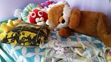 Stuffed Toys On Bed At Home