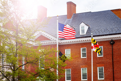 Fototapeta US flag in front of government building in Annapolis, Maryland, USA obraz