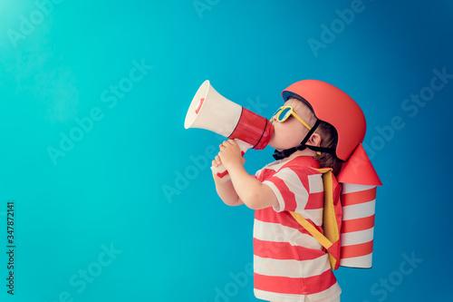 Fotografia, Obraz Happy child playing with toy paper rocket