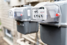 Row Of Gray Natural Gas Meters...