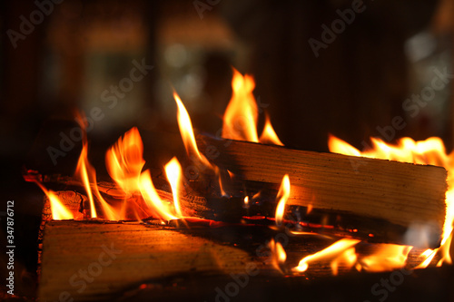 Fototapeta Fireplace with burning wood, closeup view. Winter vacation obraz