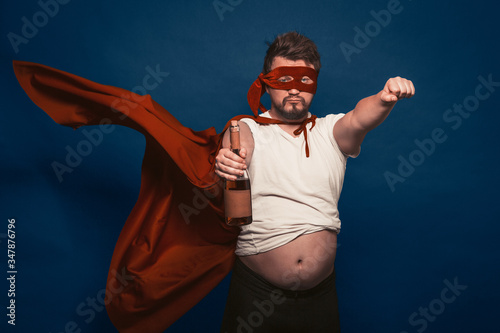 Photo Tipsy Or Drunk Superhero Holding Bottle Of Wine