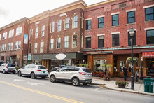Renovated Old Brick Buildings With Shops And Restaurants On The Ground Level Along A Street In A Historic Downtown On A Sunny Autumn Morning. Montpelier, VT, USA.