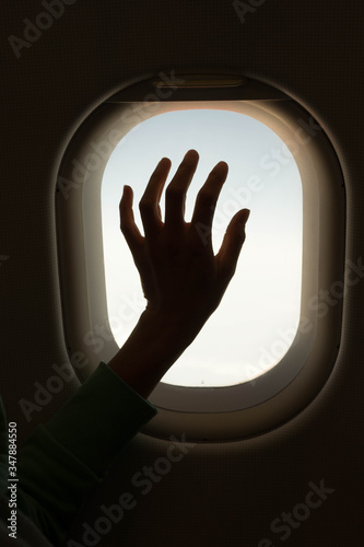 Hand touching an airplane window Canvas Print