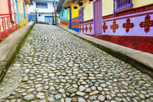 Cobbled Street Amidst Multi Colored Houses In Town