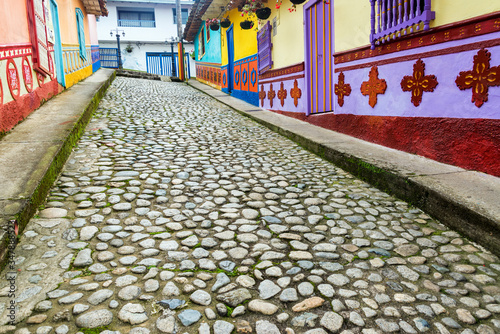 Fototapeta Cobbled Street Amidst Multi Colored Houses In Town