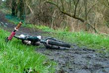 Child's Bike Found Abandoned On Muddy Pathway Wide Shot