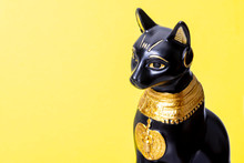 Black Egyptian Cat On Yellow Background