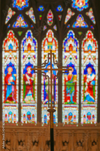 Close-up Of Cross Against Stained Glass Window Canvas Print