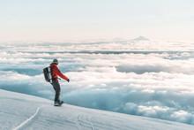 Snowboarder Riding Down Mounta...
