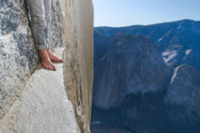 Man Standing On A Ledge, View Of Bare Foot, Very High El Capitan