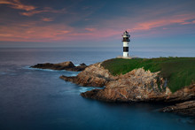 Lighthouse At Sunset In Galicia