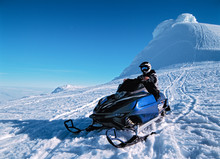 Man Riding His Snow Scooter On Snaefellsnesjokull Glacier