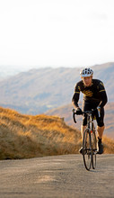 Cyclist Approaching Top Of Hil...