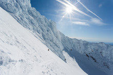 A Man Climbs To The Summit Of Mt. Hood In Oregon.