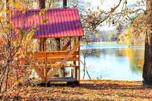 Wooden Arbor With A Table And ...