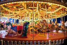 Illuminated Bright Carousel In Amusement Park