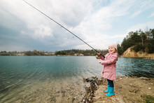 Little Girl Catching A Fish. L...