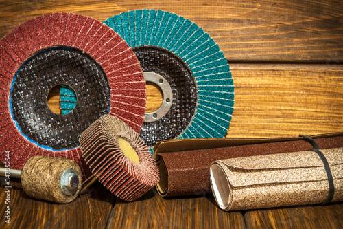 Photo Big set of abrasive tools and sandpaper on vintage wooden boards