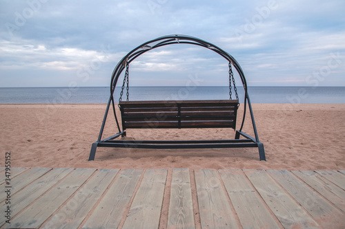 Fotografia, Obraz Lonely swings on the sandy shore of Lake Ladoga. Without people.